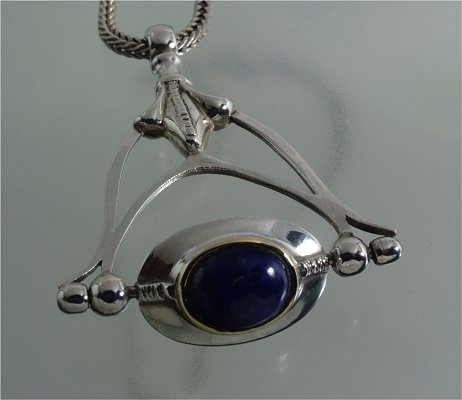 Alternating sterling silver, gold, lapis lazuli & turquoise pendant