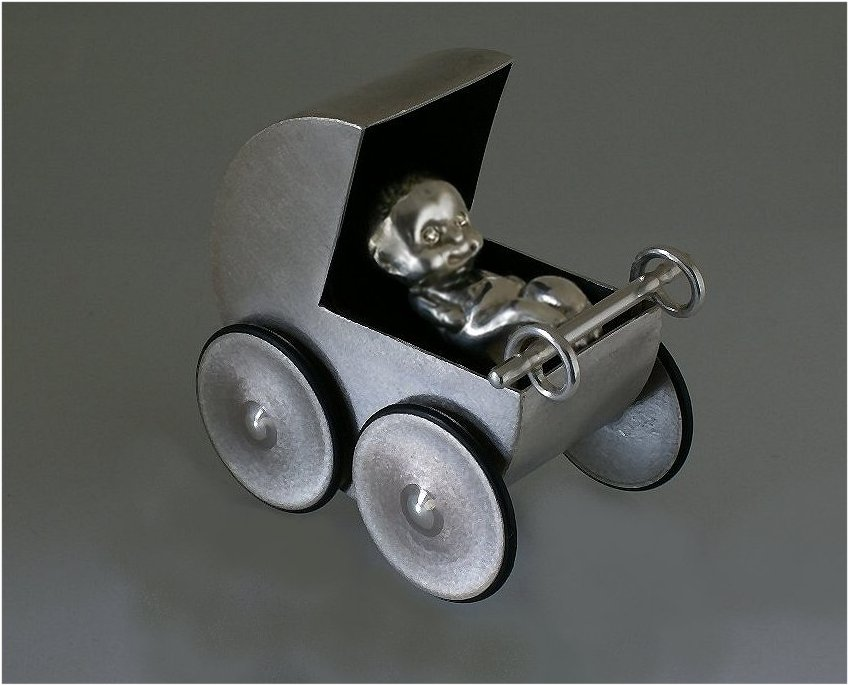 Pushable sterling silver pram and newborn baby